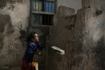 In this Feb. 12, 2018, photo, a girl pulls water from a well in the home of Ahmed al-Kawkabani, leader of the southern resistance unit in Hodeida, in al-Khoukha, Yemen. (AP Photo/Nariman El-Mofty)