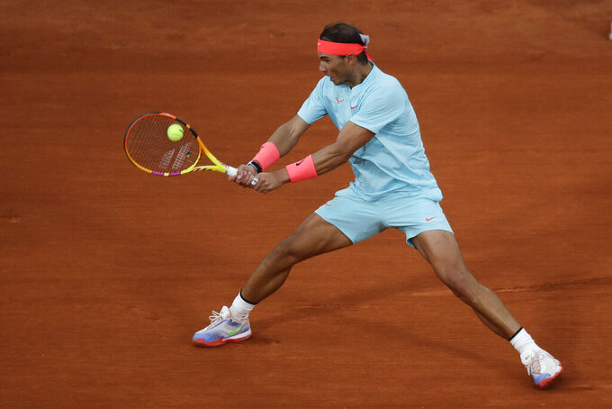Spain's Rafael Nadal plays a shot against Egor Gerasimov of Belarus in the first round match of the French Open tennis tournament at the Roland Garros stadium in Paris, France, Monday, Sept. 28, 2020. (AP Photo/Alessandra Tarantino)