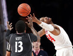 Cincinnati forward Trevon Scott (13) and Houston forward Breaon Brady (24) reach for a rebound during the first half of an NCAA college basketball game Sunday, Feb. 10, 2019, in Houston. (AP Photo/Michael Wyke)