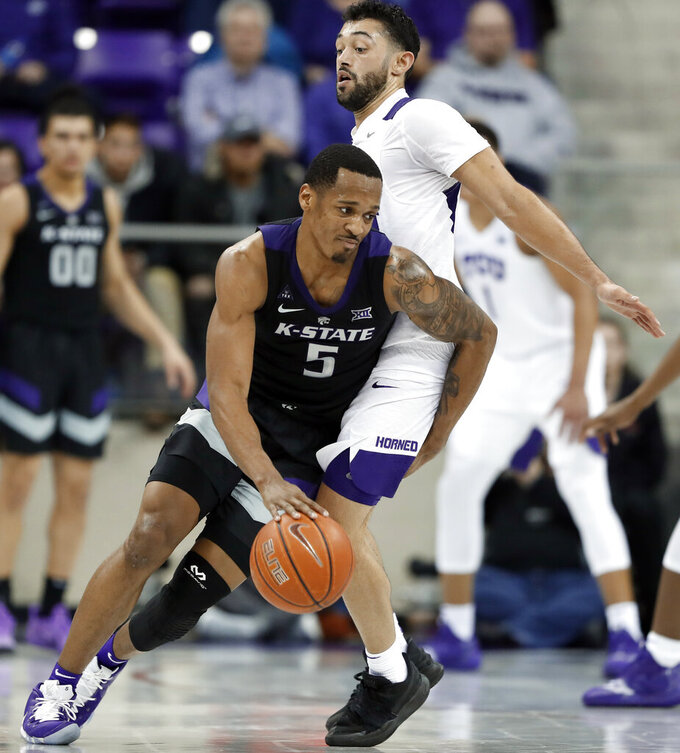 Kansas State guard Barry Brown Jr. (5) works to get around TCU guard Alex Robinson, right, in the second half of an NCAA college basketball game in Fort Worth, Texas, Monday, March 4, 2019. (AP Photo/Tony Gutierrez)