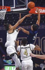 Wake Forest's Jalen Johnson blocks the shot of Longwood's Juan Munoz during the first half of an NCAA basketball game Friday, Nov. 27, 2020, in Winston-Salem, N.C. (Walt Unks/The Winston-Salem Journal via AP, Pool)