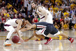 Arizona State guard Jaelen House, left, and Washington State guard Isaac Bonton, right battle for a loose ball during the first half of an NCAA college basketball game Saturday, March 7, 2020, in Tempe, Ariz. (AP Photo/Matt York)