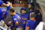 New York Mets' Andres Gimenez (60) celebrates after scoring on a double by Brandon Nimmo during the eighth inning of a baseball game against the Boston Red Sox, Tuesday, July 28, 2020, in Boston. (AP Photo/Michael Dwyer)