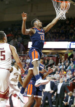 Virginia guard De'Andre Hunter (12) drives to the basket ahead of Boston College guards Jordan Chatman (25) and Jared Hamilton (3) during the first half of an NCAA basketball game Wednesday, Jan. 9, 2019, in Boston. (AP Photo/Mary Schwalm)