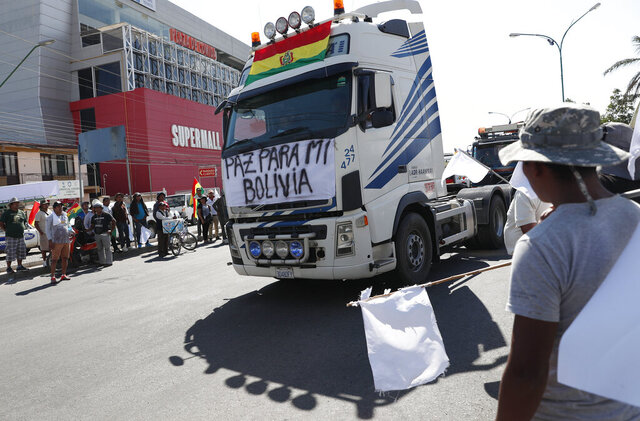 A truck passes with a sign reading in Spanish
