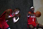 Houston Rockets' Josh Christopher, left, films himself as Danuel House Jr. (4) poses for a photographer during an NBA basketball media day Monday, Sept. 27, 2021, in Houston. (AP Photo/David J. Phillip)