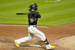 Pittsburgh Pirates' Ben Gamel follows through on a two-run single off Detroit Tigers relief pitcher Alex Lange during the sixth inning of a baseball game in Pittsburgh, Tuesday, Sept. 7, 2021. (AP Photo/Gene J. Puskar)