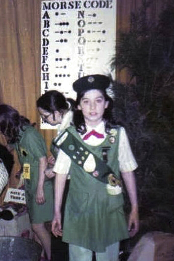 This 1982 photo, provided in New York, Tuesday Aug. 4, 2020, shows Girl Scout Alice Weiss-Russell, age 11. As a Girl Scout growing up in upstate New York, Alice Weiss-Russell says she lived with a dark secret: The husband of her troop leader was sexually abusing her in the bathroom of a church basement where scout meetings were held in the 1980s. She has detailed her alleged ordeal in a new lawsuit filed against Girl Scouts of the USA, part of a flurry of child sex-abuse cases in New York using a