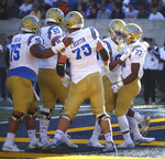 UCLA running back Joshua Kelley, right, celebrates after scoring a touchdown against California during the first half of an NCAA college football game Saturday, Oct. 13, 2018, in Berkeley, Calif. (AP Photo/Ben Margot)