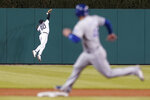 Detroit Tigers center fielder Akil Baddoo (60) can't reach a Kansas City Royals' Jorge Soler fly ball as Sebastian Rivero (48) rounds second base in the ninth inning of a baseball game in Detroit, Tuesday, May 11, 2021. (AP Photo/Paul Sancya)