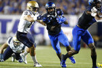 Memphis running back Kylan Watkins breaks past Navy safety Kevin Brennan during an NCAA college football game in Memphis, Tenn., Thursday, Sept. 26, 2019. (Joe Rondone/The Commercial Appeal via AP)