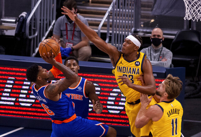 Indiana Pacers forward Myles Turner (33) attempts to block the shot of New York Knicks guard Elfrid Payton (6) during the first half of an NBA basketball game in Indianapolis, Saturday, Jan. 2, 2021. (AP Photo/Doug McSchooler)