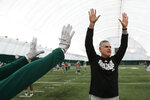 Eastern Michigan football coach Chris Creighton reacts to a drill during practice in Ypsilanti, Mich., Monday, Dec. 10, 2018. Eastern Michigan's football team has stepped out of the shadows created by the neighboring University of Michigan and four professional teams just down the road in the Motor City. The Eagles will face Georgia Southern in the Camellia Bowl on Saturday, earning a spot in NCAA football postseason play for the second time in three years and just the third time in school history. (AP Photo/Paul Sancya)