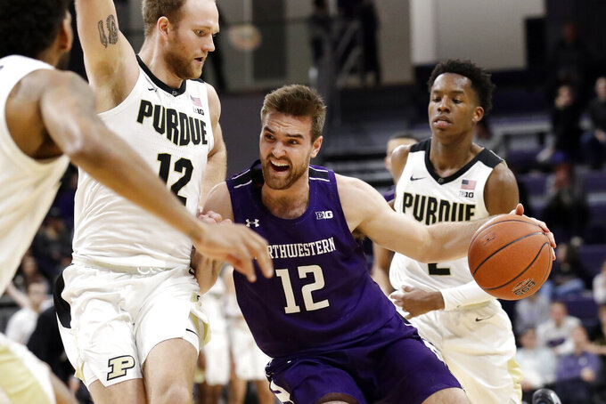 Northwestern guard Pat Spencer, front right, drives against Purdue forward Evan Boudreaux during the second half of an NCAA college basketball game in Evanston, Ill., Saturday, Feb. 1, 2020. Purdue won 61-58. (AP Photo/Nam Y. Huh)