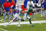 New York Jets running back Le'Veon Bell (26) makes a catch with Buffalo Bills outside linebacker Matt Milano (58) defending during the first half of an NFL football game in Orchard Park, N.Y., Sunday, Sept. 13, 2020. The Bills won 27-17. (AP Photo/John Munson)