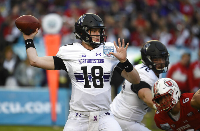 Northwestern quarterback Clayton Thorson (18) throws under pressure during the first half of the Holiday Bowl NCAA college football game against Utah, Monday, Dec. 31, 2018, in San Diego. (AP Photo/Denis Poroy)