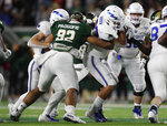 Colorado State defensive lineman Livingston Paogofie, left, tackles Air Force fullback Taven Birdow after a short gain in the first half of an NCAA football game Saturday, Nov. 16, 2019 in Fort Collins, Colo. (AP Photo/David Zalubowski)
