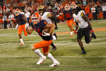 Illinois wide receiver Casey Washington heads for the end zone after picking up teammate Reggie Love's fumble during the second half of the team's NCAA college football game against Maryland on Friday, Sept. 17, 2021, in Champaign, Ill. Maryland won 20-17. (AP Photo/Charles Rex Arbogast)