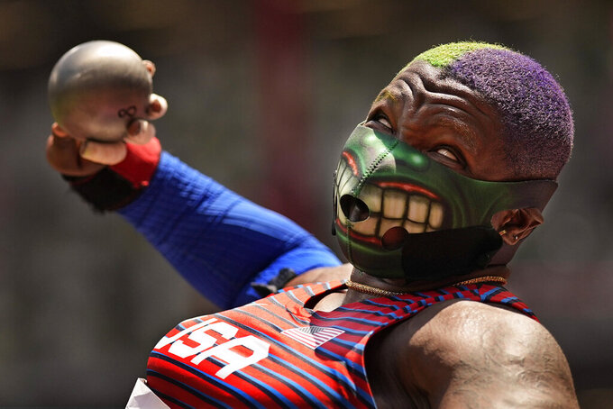 Raven Saunders, of the United States, competes in the final of the women's shot put at the 2020 Summer Olympics, Sunday, Aug. 1, 2021, in Tokyo. (AP Photo/David J. Phillip)