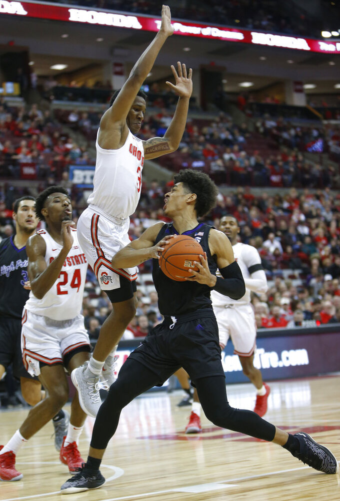 High Point's Tim Cameron, right, drives to the basket as Ohio State's C.J. Jackson defends during the first half of an NCAA college basketball game Saturday, Dec. 29, 2018, in Columbus, Ohio. (AP Photo/Jay LaPrete)