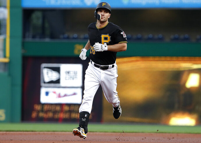 Pittsburgh Pirates' Adam Frazier rounds second after hitting a lead-off home run off Chicago White Sox starting pitcher Reynaldo Lopez during the first inning of a baseball game in Pittsburgh, Tuesday, May 15, 2018. (AP Photo/Gene J. Puskar)