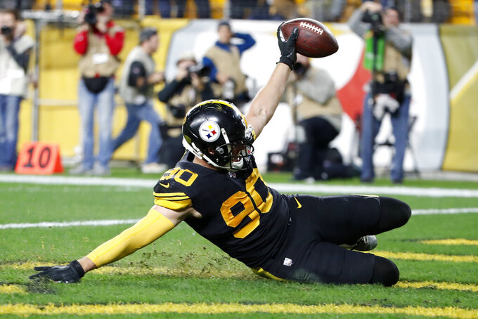 Pittsburgh Steelers outside linebacker T.J. Watt celebrates his sack of Miami Dolphins quarterback Ryan Fitzpatrick and fumble recovery by sliding into the end zone during the second half of an NFL football game in Pittsburgh, Monday, Oct. 28, 2019. (AP Photo/Don Wright)