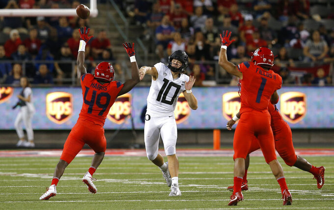 Oregon quarterback Justin Herbert (10) throws down field against Arizona in the second half during an NCAA college football game, Saturday, Oct. 27, 2018, in Tucson, Ariz. Arizona defeated Oregon 44-15. (AP Photo/Rick Scuteri)