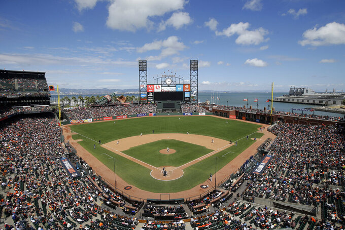 FILE - This June 15, 2016, file photo shows AT&T Park from an overhead view as the San Francisco Giants play the Milwaukee Brewers during a baseball game in San Francisco. The Oakland Raiders are in talks with the Giants about playing their home games next season at Oracle Park, formerly known as AT&T Park. A person with knowledge of the negotiations said Sunday night, Feb. 3, 2019, the two sides are in discussions, but no deal has been reached. The person spoke to The Associated Press on condition of anonymity because nothing has been finalized. (AP Photo/Marcio Jose Sanchez, File)