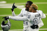 Las Vegas Raiders cornerback Isaiah Johnson, left, and strong safety Johnathan Abram (24) celebrate after the Raiders defeated the Los Angeles Chargers in an NFL football game Sunday, Nov. 8, 2020, in Inglewood, Calif. (AP Photo/Alex Gallardo)