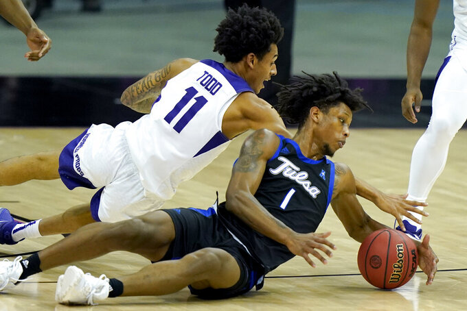 TCU's Taryn Todd (11) and Tulsa's Brandon Rachal (1) chase the ball during the second of an NCAA college basketball game Saturday, Nov. 28, 2020, in Kansas City, Mo. (AP Photo/Charlie Riedel)
