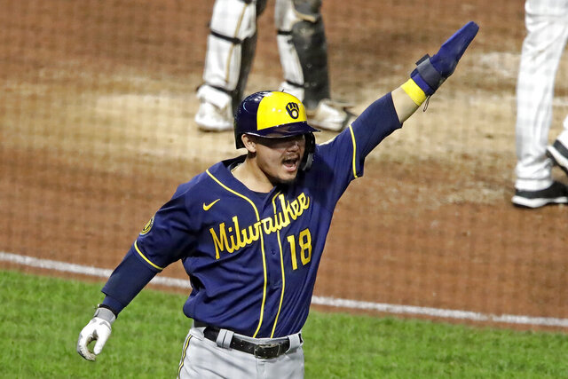 Milwaukee Brewers' Keston Hiura celebrates after he and Lorenzo Cain scored on a double by Ryan Braun off Pittsburgh Pirates relief pitcher Kyle Crick during the ninth inning of a baseball game in Pittsburgh, Monday, July 27, 2020. (AP Photo/Gene J. Puskar)