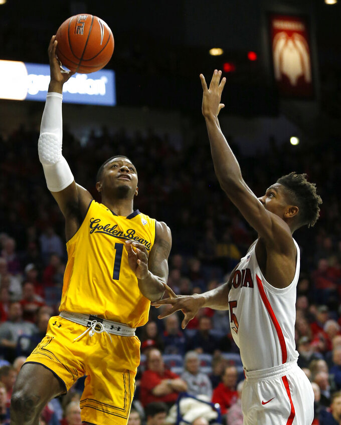 California guard Darius McNeill (1) shoots over Arizona guard Brandon Randolph during the first half of an NCAA college basketball game Thursday, Feb. 21, 2019, in Tucson, Ariz. (AP Photo/Rick Scuteri)