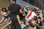 Anti-government protesters scuffle with Lebanese army soldiers in the town of Zouk Mosbeh, north of Beirut, Lebanon, Tuesday, Nov. 5, 2019. Lebanese troops deployed in different parts of the country Tuesday reopening roads and main thoroughfares closed by anti-government protesters facing resistance in some areas that led to scuffles. (AP Photo/Hassan Ammar)