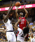 Incarnate Word's Morgan Taylor (20) heads to the basket as Missouri's Kobe Brown (24) and Dru Smith (12) defend during the first half of an NCAA college basketball game Wednesday, Nov. 6, 2019, in Columbia, Mo. (AP Photo/Jeff Roberson)