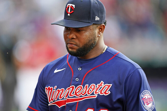 Minnesota Twins relief pitcher Alex Colome walks off the field after giving up a two-run home run to Cleveland Indians' Cesar Hernandez in the 10th inning of a baseball game, Saturday, May 22, 2021, in Cleveland. (AP Photo/Tony Dejak)