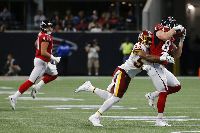 Atlanta Falcons tight end Jaeden Graham (87) makes the catch against Washington Redskins inside linebacker Jon Bostic (53) during the first half an NFL preseason football game, Thursday, Aug. 22, 2019, in Atlanta. (AP Photo/Andrea Smith)