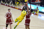 Oregon guard Amauri Hardy (11) shoots between Stanford forwards Spencer Jones (14) and Max Murrell (10) during the first half of an NCAA college basketball game in Stanford, Calif., Thursday, Feb. 25, 2021. (AP Photo/Jeff Chiu)