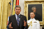 FILE - In this Aug. 22, 2019, file photo, Sen. Joe Manchin, D-W.Va., speaks during a Presidential Medal of Freedom ceremony for former NBA basketball player and coach Bob Cousy, of the Boston Celtics, in the Oval Office of the White House in Washington.  (AP Photo/Alex Brandon, File)