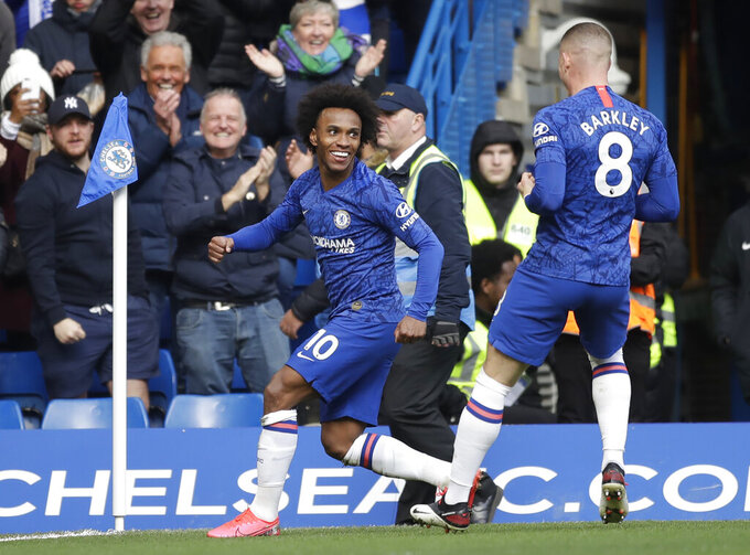 Chelsea's Willian, left, celebrates with Ross Barkley after scoring his side's third goal during the English Premier League soccer match between Chelsea and Everton at Stamford Bridge stadium in London, England, Sunday, March 8, 2020. (AP Photo/Matt Dunham)