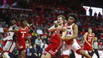 Rutgers guard Ron Harper Jr. (24) wrestles the ball away from Wisconsin forward Tyler Wahl (5) during the second half of an NCAA college basketball game in Piscataway, N.J., Wednesday, Dec. 11, 2019. (Andrew Mills/NJ Advance Media via AP)