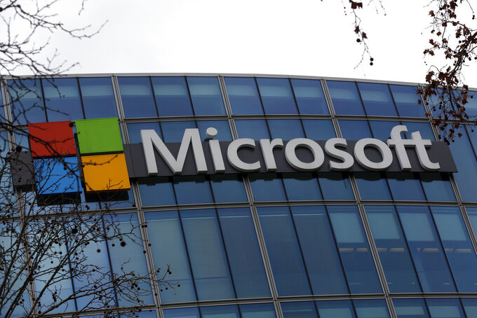 FILE - This Jan. 8, 2021 file photo shows the logo of Microsoft displayed outside the headquarters in Paris. Microsoft's business beat Wall Street expectations for the first three months of 2021, thanks to ongoing demand for its software and cloud computing services during the pandemic. The company on Tuesday, April 27, 2021 reported fiscal third-quarter profit of $14.8 billion, up 38% from the same period last year. (AP Photo/Thibault Camus, file)