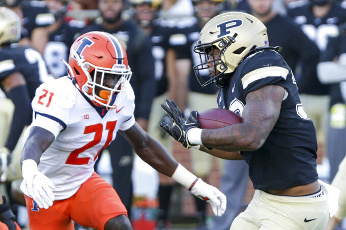 Purdue running back Dylan Downing (38) runs the ball against Illinois defensive back Jartavius Martin (21) during the fourth quarter of an NCAA college football game, Saturday, Sept. 25, 2021, in West Lafayette, Ind. (Nikos Frazier/Journal & Courier via AP)