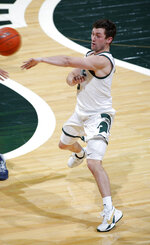Michigan State's Foster Loyer throws a pass during the second half of the team's NCAA college basketball game against Notre Dame, Saturday, Nov. 28, 2020, in East Lansing, Mich. Michigan State won 80-70. (AP Photo/Al Goldis)