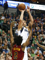 Dallas Mavericks forward Dirk Nowitzki (41) shoots over Cleveland Cavaliers guard Collin Sexton (2) during the first half of an NBA basketball game in Dallas, Saturday, March 16, 2019. (AP Photo/Michael Ainsworth)