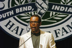 "FILE - In this June 2, 2004, file photo, Gale Sayers addresses a luncheon sponsored by the College Football Hall of Fall in South Bend, Ind. Hall of Famer Gale Sayers, who made his mark as one of the NFL's best all-purpose running backs and was later celebrated for his enduring friendship with a Chicago Bears teammate with cancer, has died. He was 77. Nicknamed ""The Kansas Comet"" and considered among the best open-field runners the game has ever seen, Sayers died Wednesday, Sept. 23, 2020, according to the Pro Football Hall of Fame. (AP Photo/Joe Raymond, File)"
