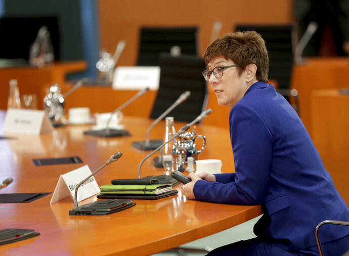 German Defence Minister Annegret Kramp-Karrenbauer speaks prior to the weekly cabinet meeting at the Chancellery in Berlin, Germany, Wednesday, July 8, 2020. (AP Photo/Michael Sohn, pool)