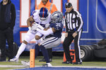 New York Giants wide receiver Golden Tate (15) comes down with a catch just in front of the goal line against Dallas Cowboys cornerback Byron Jones (31) during the second quarter of an NFL football game, Monday, Nov. 4, 2019, in East Rutherford, N.J. (AP Photo/Bill Kostroun)