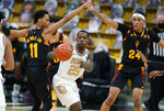 Colorado guard McKinley Wright IV, center, passes the ball as Arizona State guard Alonzo Verge Jr., left, and forward Jalen Graham defend during the first half of an NCAA college basketball game Thursday, March 4, 2021, in Boulder, Colo. (AP Photo/David Zalubowski)