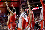 Ohio State's Joey Lane, center, celebrates between Musa Jallow (2) and Jaedon LeDee (23) during the second half of an NCAA college basketball game against Nebraska in Lincoln, Neb., Saturday, Jan. 26, 2019. Ohio State won 70-60. (AP Photo/Nati Harnik)
