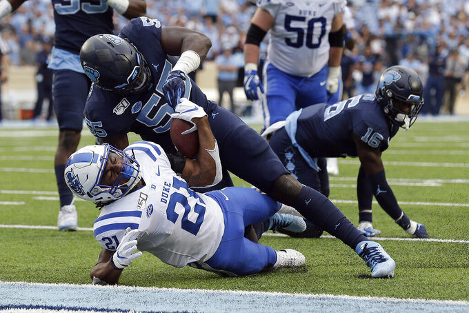 North Carolina defensive lineman Jason Strowbridge (55) stops Duke running back Mataeo Durant (21) short of a touchdown during the first half of an NCAA college football game in Chapel Hill, N.C., Saturday, Oct. 26, 2019. (AP Photo/Gerry Broome)